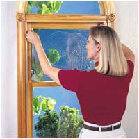 Picture of Woman applying window film.