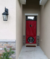 Blower door curtain installed in doorway at end of long entrance