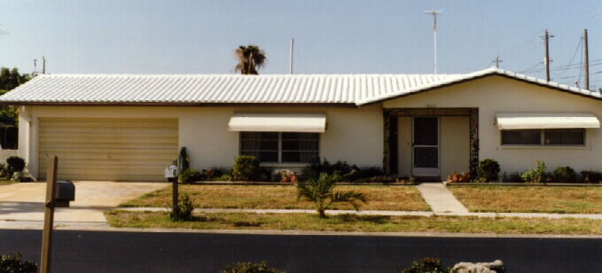 Photo Of House With White Roof